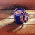 Blue coffee mug on a table in early morning light.